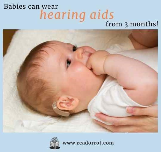 Baby with a hearing aid.